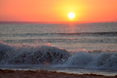 Early morning, the image of the sea at the sunrise. Waves, red s Stock Photos