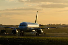Early morning jet airliner on runway Stock Photos