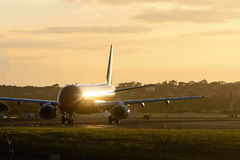 Early morning jet airliner on runway Royalty Free Stock Image