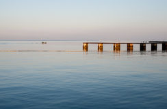 Early morning, jetty and boat Stock Photos