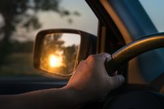 Early in the morning journey by car. Man`s hands. Close up Royalty Free Stock Images