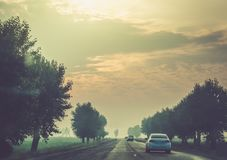 Early in the morning journey by car. Golden hour Stock Photography