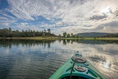 Morning kayak expedition in peaceful lake royalty free stock images