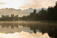 Early morning Lake Matheson with cloudy sky  with mount cook with reflection. New Zealand west coast natural landscape Royalty Free Stock Images