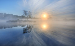 Early morning. On a lake with a small island at sunrise Stock Photos