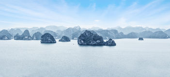 Early morning landscape with blue fog and limestone rocks at Ha Stock Photos