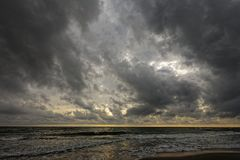 Early morning, landscape with large clouds away, and storm Stock Photos