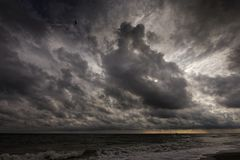 Early morning, landscape with large clouds away, and storm Royalty Free Stock Images