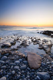 Early morning landscape of ocean over rocky shore Royalty Free Stock Images