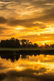 Early morning landscape, sky reflecting in the lake Stock Photo