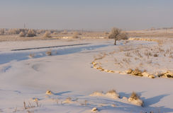 Early morning landscape with small frozen river Stock Photo