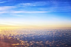 Early morning light bright sky above cloud on the plane view. Early morning ray light and bright sky above cloud on the plane view royalty free stock photo