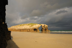 Early morning in llas Catedrales beach. Las Catedrales beach. Ribadeo, Spain. Last ray of sun in the early morning before the rain Stock Image
