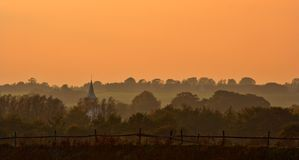 Early morning mist. In sunrise. Very useful as background, room for text Stock Image