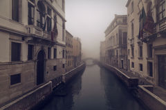 Early morning mist on a canal in venice Stock Photos