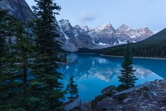Early Morning at Moraine Lake in Banff National Park. Moraine Lake reflects the Canadian Rockies in the early morning in Banff National Park, Alberta, Canada Stock Photos