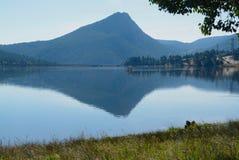 Mountain Peak Reflected on Lake Estes. Early morning mountain reflection on Lake Estes at Estes Park, Colorado royalty free stock photo