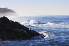 Early Morning Ocean Waves ~ Rock Jetty and Bluffs. Early Morning Ocean Waves ~ Rock Jetty and Misty Bluffs Stock Photography