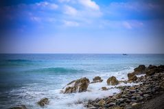 Early morning Pacific South China Sea Seascape. With wavy seas and lazy clouds in the skies Royalty Free Stock Image
