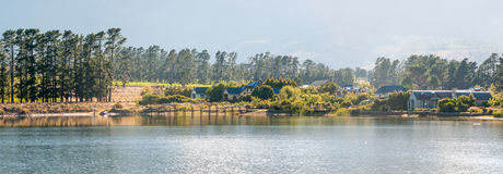Early morning panorama of houses next to a dam Royalty Free Stock Images