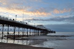 Worthing pier at dawn. Early morning photo of Worthing pier at dawn at low tide Royalty Free Stock Image