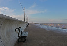 Early morning promenade showing sea defences. Royalty Free Stock Photos
