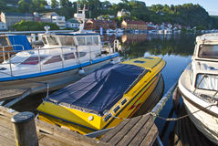 Early morning on quayside in Halden (speedboat) Royalty Free Stock Photography
