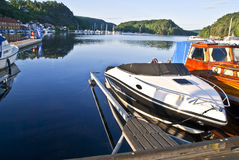 Early morning on quayside in Halden (speedboat) Royalty Free Stock Photo