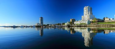 Early Morning Reflection in Still Waters of Nanaimo Harbour, Vancouver Island Stock Image