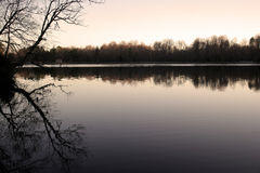 Early Morning Reflections. On Killen's Pond in Delaware with copyspace in the water or sky Royalty Free Stock Images
