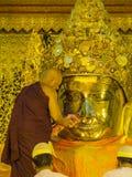 Early morning ritual of face wash to MahaMyat Muni Buddha Image Stock Photography