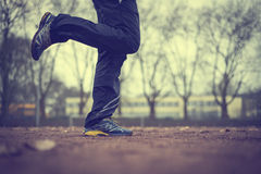 Early morning run. Jogging on the stadion-sport field Royalty Free Stock Images