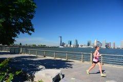 Early morning runners Battery Park City Promenade, NYC Stock Photo