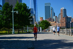Early morning runners Battery Park City Promenade, NYC Stock Photo