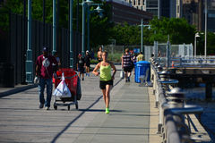 Early morning runners Battery Park City Promenade, NYC Royalty Free Stock Images