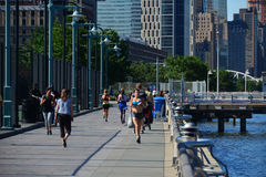 Early morning runners Battery Park City Promenade, NYC Stock Photos