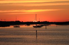 Early Morning Sailing in Sarasota, Florida. Boats anchored on the bay at sunrise Royalty Free Stock Image
