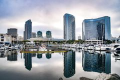 Reflection of San Diego in Still Waters. Early morning at the San Diego Bay shows a still water reflection of the downtown skyline stock images