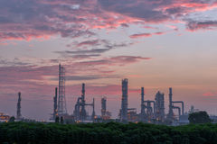 Early morning scene of oil refinery plant. Royalty Free Stock Images