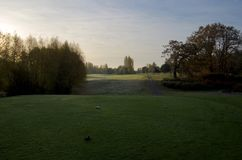 Early morning shadows and dew cover the lawns of Cedar Hill Golf Course as seen from a tee off stock photo