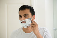 Early morning shave Stock Images