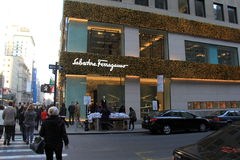 Early morning shoppers walking by gorgeous storefront decorated for Christmas, Salvatore Ferragamo, NYC,2015 Royalty Free Stock Photo