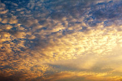 Early morning sky with colors from deep blue to orange. Royalty Free Stock Photography