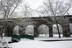 Early morning with snow covered arched bridge. Early morning with snow covered London Underground bridge Royalty Free Stock Photos