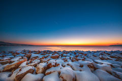 Early morning with snow covered stones stock photos