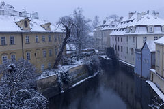 Early Morning snowy historical Prague Mill above gutter Certovka, Czech republic Stock Photos