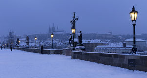 Early Morning snowy Prague Lesser Town with Bridge Tower, Castle and St. Nicholas' Cathedral from Charles Bridge Stock Photography