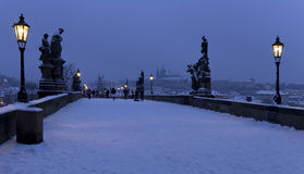 Early Morning snowy Prague Lesser Town with Bridge Tower and St. Nicholas' Cathedral from Charles Bridge, Czech republic Royalty Free Stock Photos
