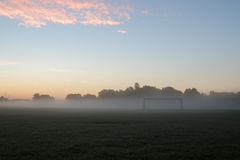 Early morning soccer goal Royalty Free Stock Images