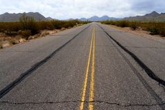 Sonora desert road with saguaro cactus Royalty Free Stock Image